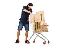 Man shopping with supermarket basket cart isolated Stock Photos