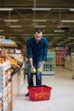 Man Shopping At The Supermarket Royalty Free Stock Photo