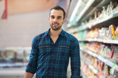 Man Shopping In Supermarket. Handsome Young Man Shopping For Fruits And Vegetables In Produce Department Of A Grocery Store - Supermarket - Shallow Deep Of Field Royalty Free Stock Photo