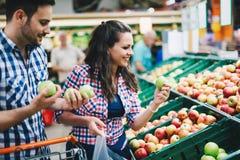 Man shopping in supermarket while pushing cart royalty free stock photography
