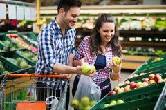 Man shopping in supermarket while pushing cart royalty free stock photos