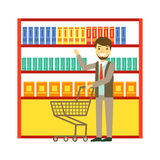 Man shopping at supermarket with shopping cart and buying products. Shopping in grocery store, supermarket or retail. Shop. Colorful character vector Stock Image