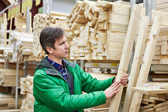 Man shopping for timber in DIY shop Royalty Free Stock Images