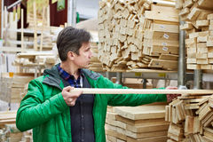 Man shopping for timber in shop Royalty Free Stock Images