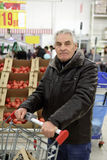 Man with shopping trolley Stock Photography