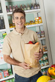 Man shopping a vegetables. Happy man buying some vegetables Royalty Free Stock Photo