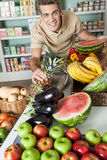 Man shopping a vegetables. Happy man buying some fruit Royalty Free Stock Image