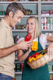 Man shopping a vegetables. Pretty women selling some vegetables Stock Photos