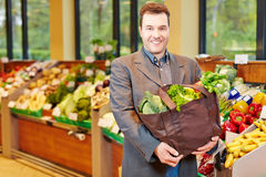 Man shopping for vegetables in supermarket Royalty Free Stock Image
