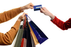 Man shopping, woman paying. Royalty Free Stock Photo