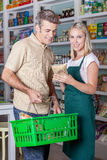 Man shopping. Woman selling a healthy food Royalty Free Stock Image