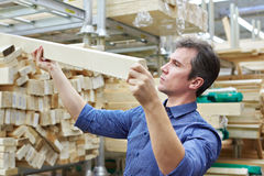Man shopping for wooden timber in shop Royalty Free Stock Photography