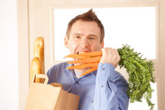 Man with shoppings Royalty Free Stock Image