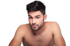 Man with short beard looking a little surprised. Young man with short beard looking a little surprised on white background stock photo