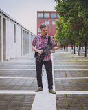 Man in short sleeve shirt playing electric guitar Royalty Free Stock Photography