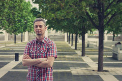 Man in short sleeve shirt standing in the street Royalty Free Stock Photography