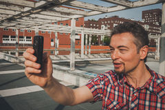 Man in short sleeve shirt taking a selfie Royalty Free Stock Photos