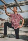 Man in short sleeve shirt taking a selfie Stock Photos