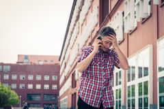 Man in short sleeve shirt talking on phone Royalty Free Stock Image