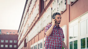 Man in short sleeve shirt talking on phone Royalty Free Stock Photo