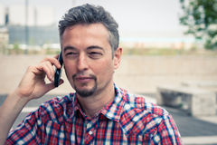 Man in short sleeve shirt talking on phone Royalty Free Stock Photos