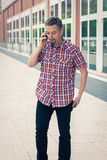 Man in short sleeve shirt talking on phone Stock Photos