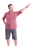 Man with shorts and shirt looking and showing up Royalty Free Stock Photos