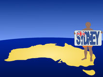 Man in shorts with Sydney sign Stock Photo