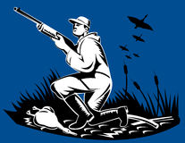 Man with shotgun duck hunting Stock Photo