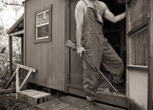 Man with Shotgun and Overalls at Hunting Camp Stock Images