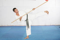 Man in shotokan karate with a bo in his hands Stock Images