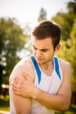 Man with shoulder injury Stock Images