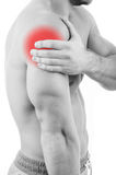 Man with shoulder pain. Over white background stock photography