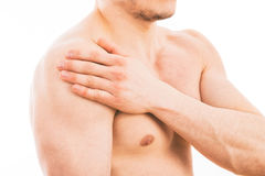 Man with shoulder pain. Over white background stock image