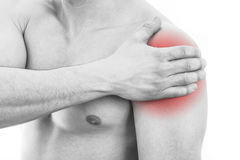 Man with shoulder pain. Over white background stock photos