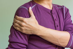 Man with shoulder pain. Young man with shoulder pain royalty free stock photos