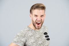 Man shout angry in tshirt on grey background Stock Image