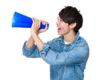Man shout with megaphone. Isolated on white background Royalty Free Stock Photography