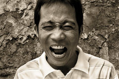 Man shouting. Closeup artistic monochrome emotional portrait of good-looking gorgeous man shouting, standing against an old wall background Royalty Free Stock Photo
