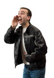 Man Shouting. A young man bent over shouting something, isolated against a white background Royalty Free Stock Photo