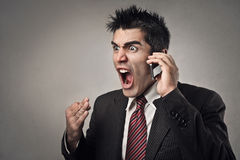 Man shouting. Angry businessman shouting at the phone Stock Images
