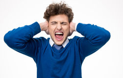 Man shouting and covering his ears Stock Photo