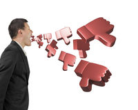 Man shouting with 3D thumbs down spraying out Stock Photo