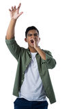 Man shouting and gesturing against white background Stock Photos