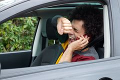 Man shouting getting into accident with car talking on the phone. Man screaming because of accident with car Royalty Free Stock Image