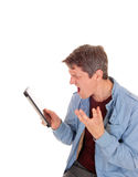 Man shouting on his tablet. Royalty Free Stock Photography