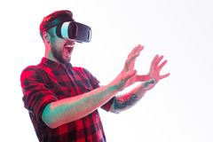 Man shouting and interacting with virtual reality Stock Photo