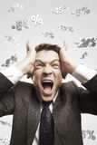 Man shouting loud under falling percents signs. Portrait of a young man shouting loud under falling percents signs above his head. Discount concept depicting Stock Photo