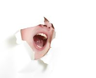 Man shouting loudly through hole in paper royalty free stock photo