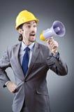 Man shouting  with loudspeaker Stock Images